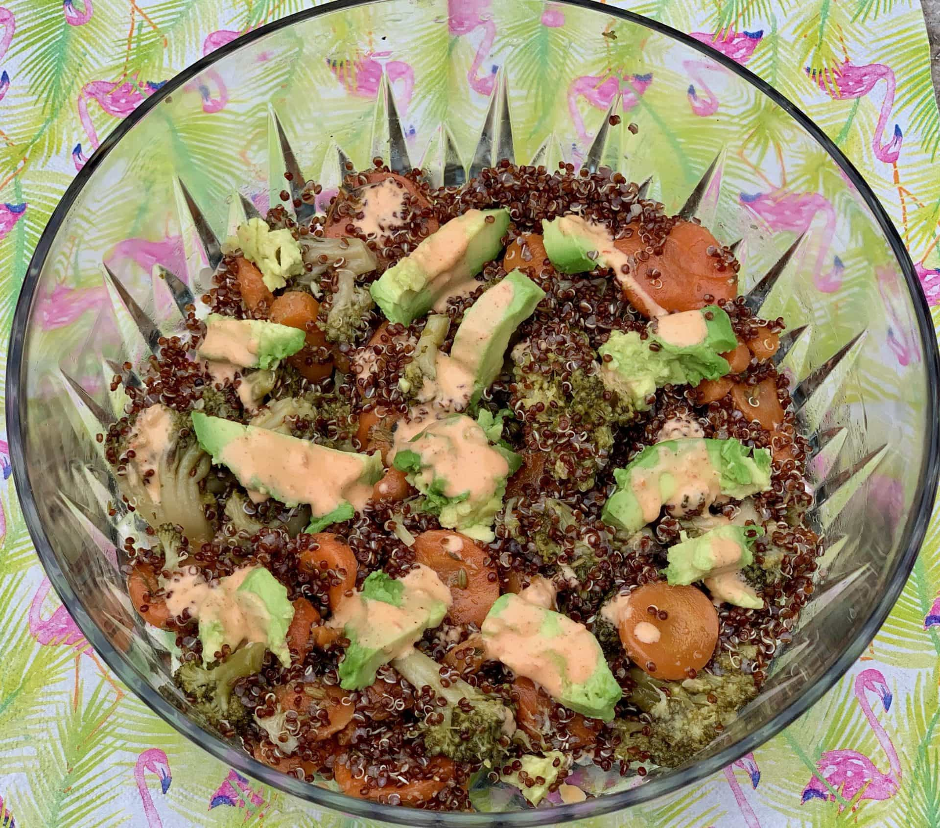 Red quinoa with carrots, broccoli, avocados, and harissa dressing